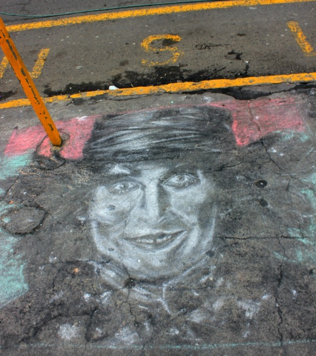 Quito - graffiti parking lot face